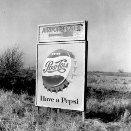 Airport Café Pepsi road sign in Weber County