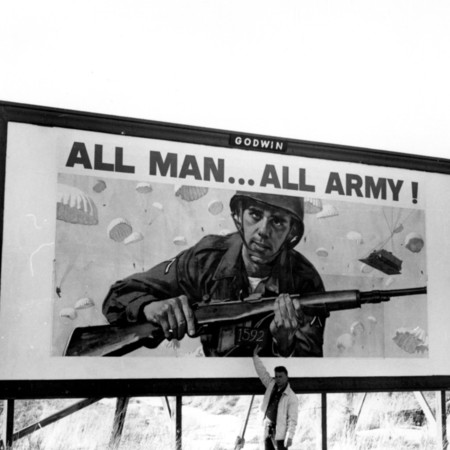All Man All Army road sign in Garfield County